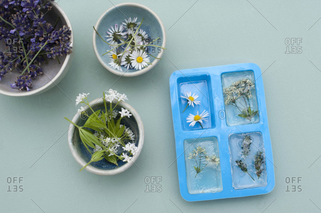 Preparation on various wildflowers andglycerin material for homemade bars of soap