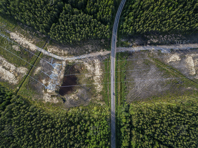 Russia- Leningrad Oblast- Tikhvin- Aerial view of electricity pylons in middle of deforested area