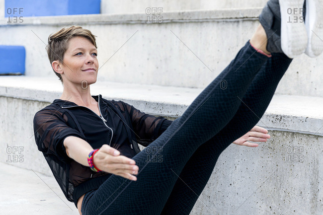 Sportive woman during workout on stairs