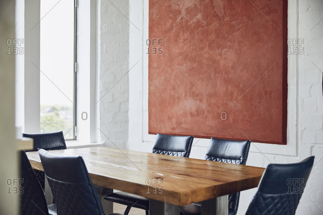 Interior of a loft flat with dining table and chairs