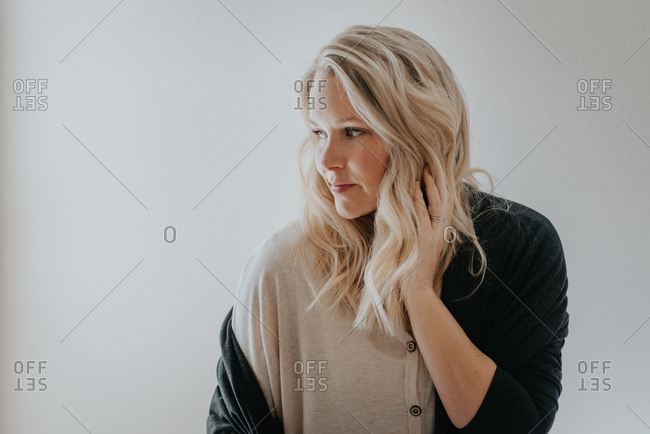 Blonde woman looking out window