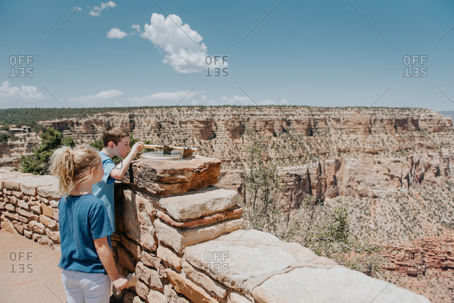 Boy and girl looking out at the Grand Canyon