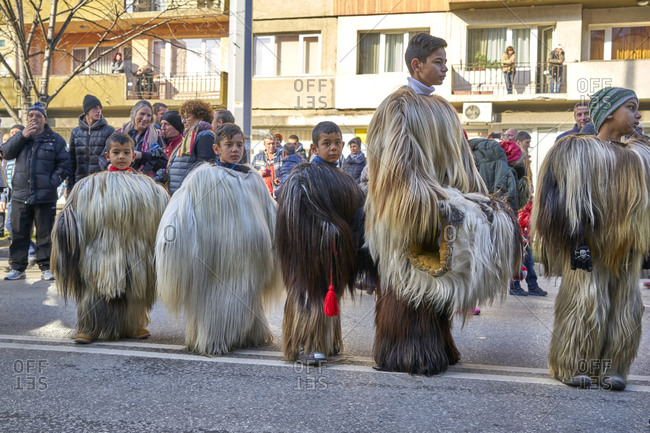 Blagoevgrad, Bulgaria - January 7, 2018: Kids in costumes at the Kukeri festival street parade.