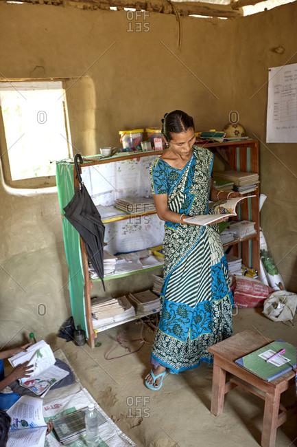 Bangladesh - April 29, 2013: Female primary school teacher teaching at Alubari Kanitus primary school