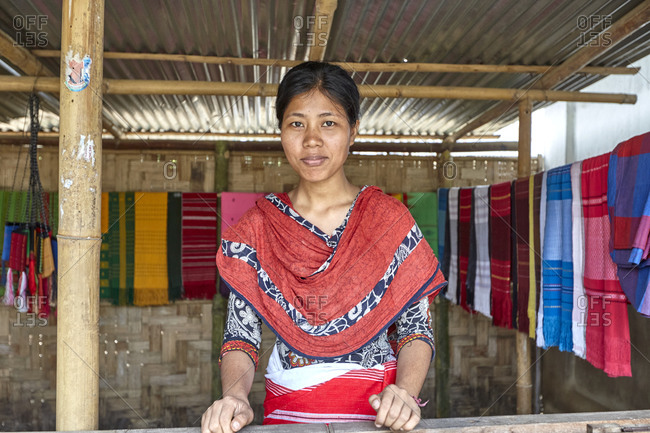 Dulochora Village, Sreemangal, Bangladesh - April 30, 2013: Portrait of a Tripura woman working in a shop selling colorful handmade textiles