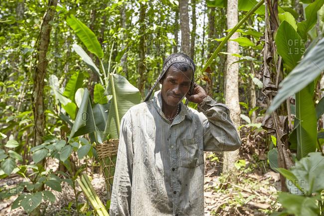 Nirala Para village, Bangladesh - May 1, 2013: A Khasi tribal man working in the rainforest