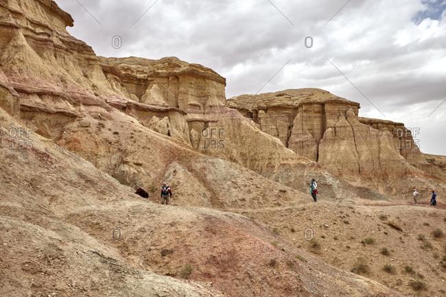 Gobi Desert, Mongolia - July 13, 2015: People exploring the ancient ruins of Tsagaan Suvarga in the Gobi Desert