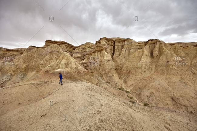 Gobi Desert, Mongolia - July 13, 2015: Man exploring the ancient ruins of Tsagaan Suvarga in the Gobi Desert