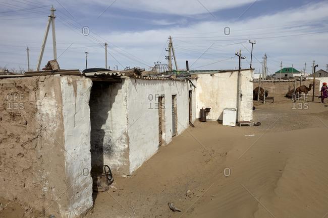 Erbent, Turkmenistan - May 15, 2016: Buildings in the Yerbent village in the Karakum Desert in central Turkmenistan