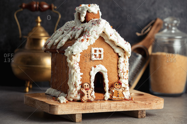 Gingerbread Christmas house with cream on a table