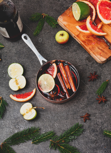 Ingredients for mulled wine in a pot on a table