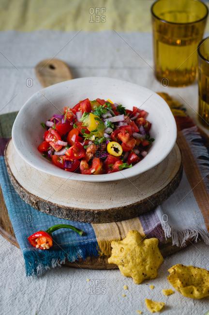 Pico de gallo (hot Mexican salsa) in a ceramic bowl