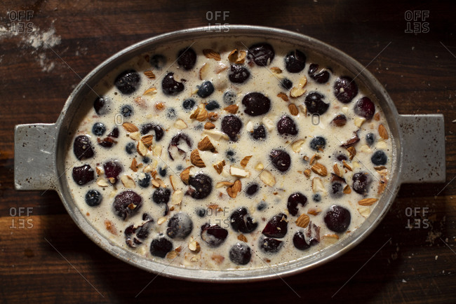Clafoutis batter with cherries uncooked