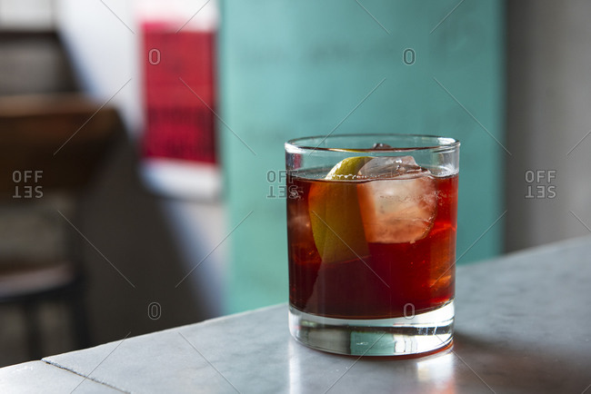 Red cocktail on the rocks