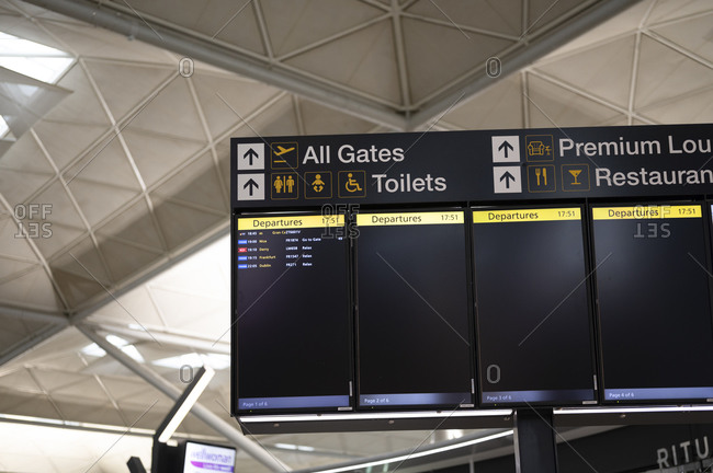 London, United Kingdom - July 08, 2020: Almost empty boarding time monitor screen in departure terminal during Covid-19 pandemic at Stanstead Airport