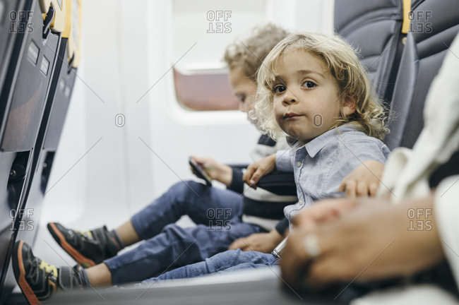 Boy on airplane waits for departure