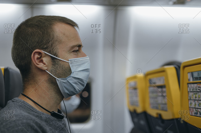 Man wearing a mask on airplane