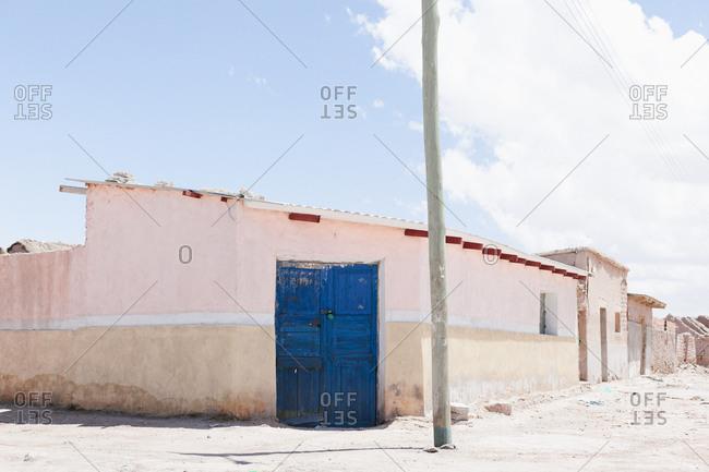 Blue door in Uyuni village in Bolivia, South America