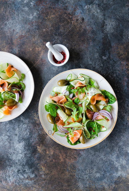 Two plates of smoked salmon salad