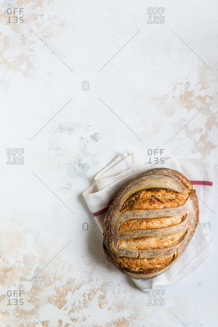 Loaf of freshly baked homemade sourdough bread, top view