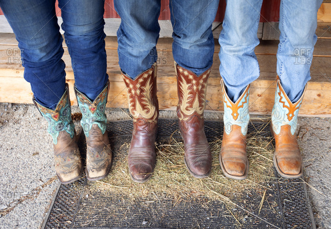 Horse riders wearing cowboy boots, Merritt, British Columbia, Canada