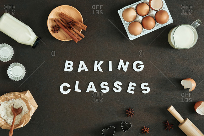 Baking class written in white letters on table, surrounded by baking tools.