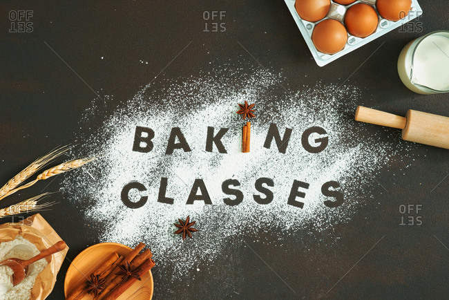 Baking classes written with flour, surrounded by ingredients
