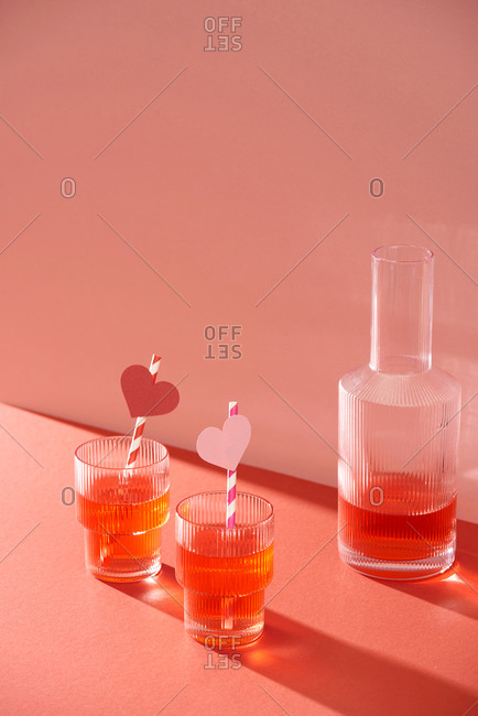 Crystal glasses with red fruit drinks