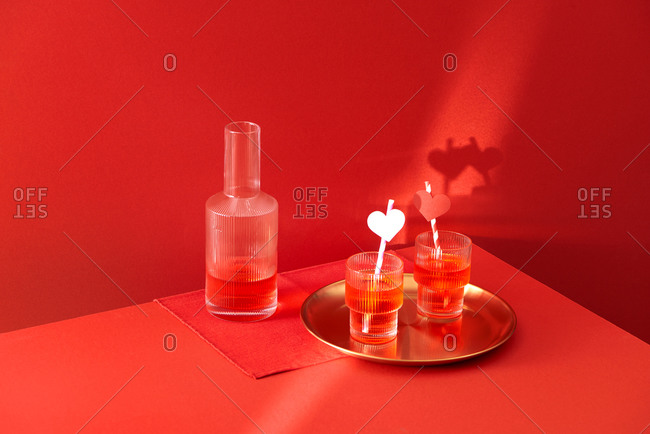 Red cocktail drinks on red background