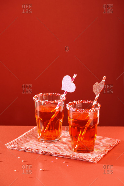 Red cocktails on red background