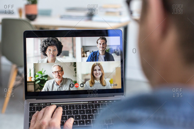 Person Using Video Conferencing technology for business meeting