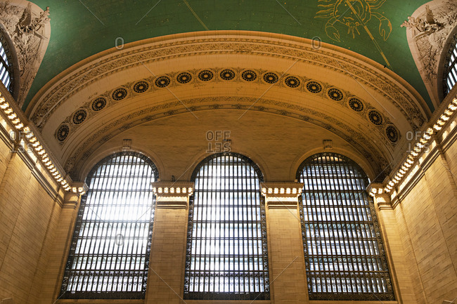 Low angle view of three arched windows in Grand Central Station in Manhattan, New York City