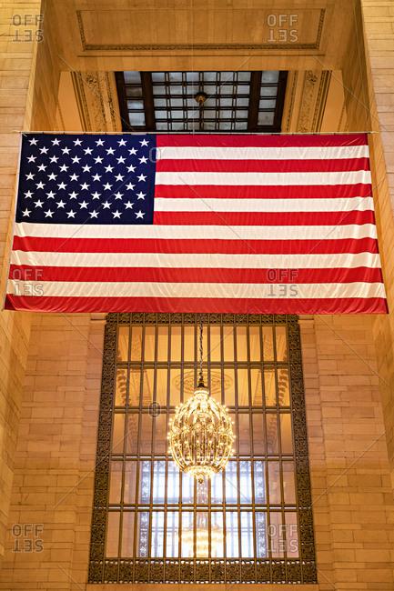 Flag above chandelier in Grand Central Station, Midtown Manhattan, New York City