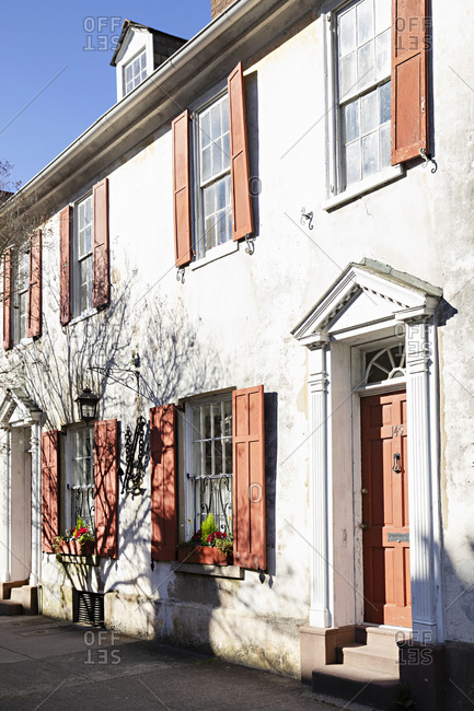 Charleston, South Carolina - March 6, 2019: Old row homes with red doors and shutters
