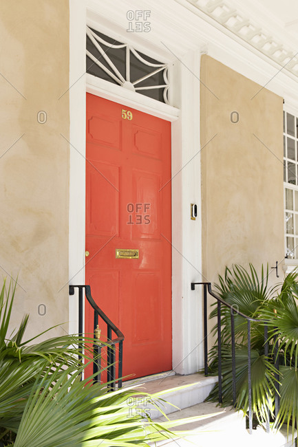 Charleston, South Carolina - March 6, 2019: Residential home with a bright colored door