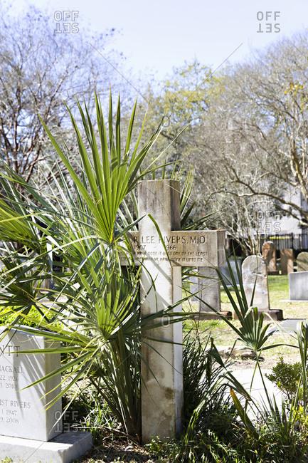 Charleston, South Carolina - March 6, 2019: Cross tomb stone Saint Philip's Episcopal Church Cemetery