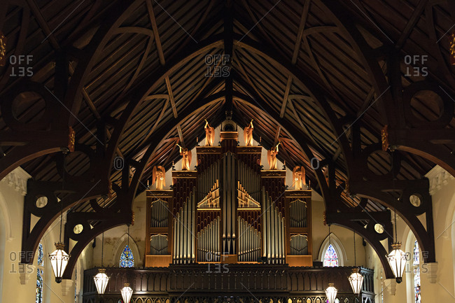 Savannah, Georgia - March 7, 2019: Angels above organ pipes in the inside of the St John's Church