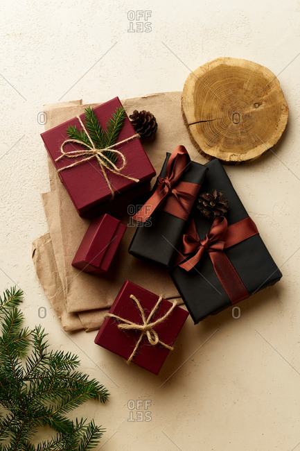 Overhead image of wrapped and decorated gifts and boxes with presents on beige background