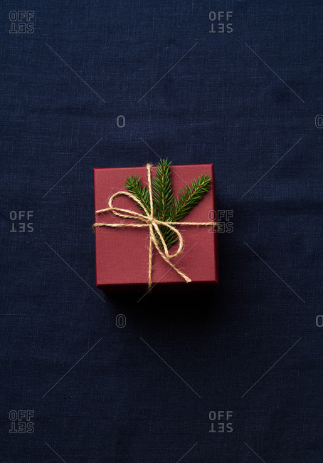 Top view of wrapped and decorated gifts and boxes with presents on blue textile background
