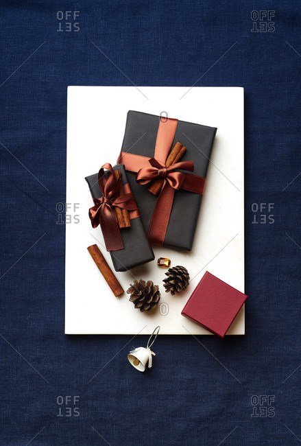 Overhead image of wrapped and decorated gifts and boxes with presents on white marble surface