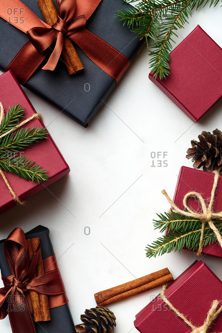 Overhead image of wrapped and decorated gifts and boxes with presents on white marble surface with text space