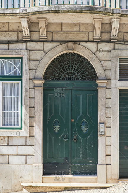 Dark green double door on home in the Lapa neighborhood, Lisbon, Portugal