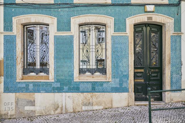 Home exterior with blue tile around window and door, Lapa neighborhood, Lisbon, Portugal