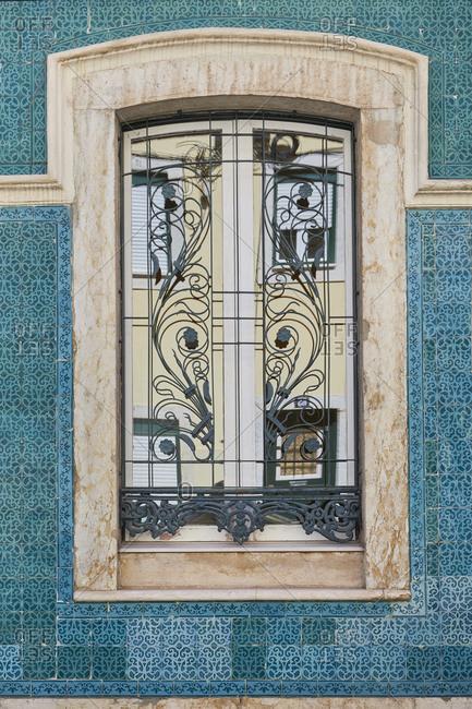 Home exterior with blue tile around window, Lapa neighborhood, Lisbon, Portugal