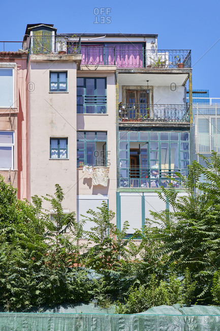 Multicolored apartments with balconies in the Lapa neighborhood in Lisbon