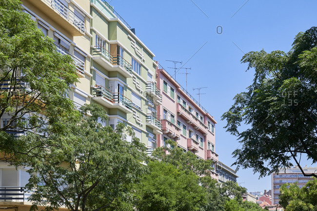 Low angle view of multicolored apartments with balconies in the Lapa neighborhood in Lisbon