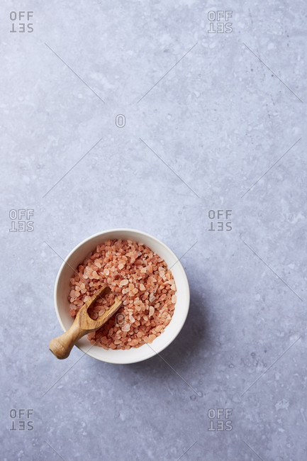 Himalayan rock salt in a bowl on light background