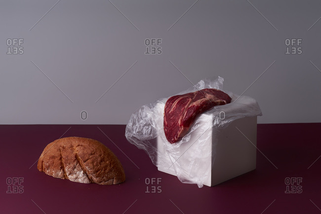 Still life with beef steak and bread slice.