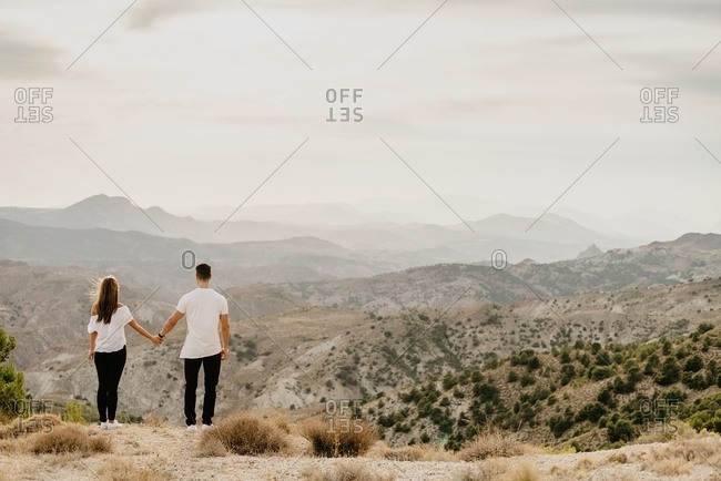 Young couple in love enjoying in mountains