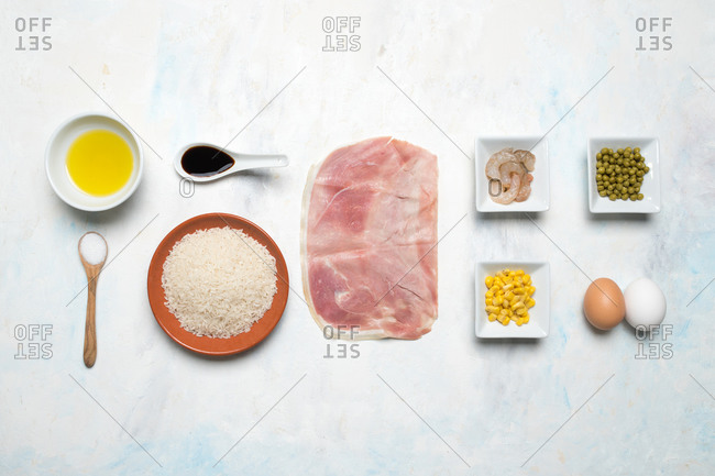 Top view of palatable products arranged in even rows on table for preparing delicious Asian dish